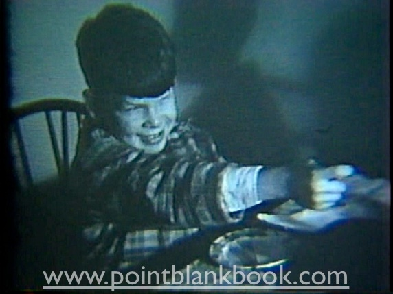 In this screen capture from his father's home movie, young Lee is shown aiming a toy gun at a friend's party just as he would as Liberty Valance, decades later.