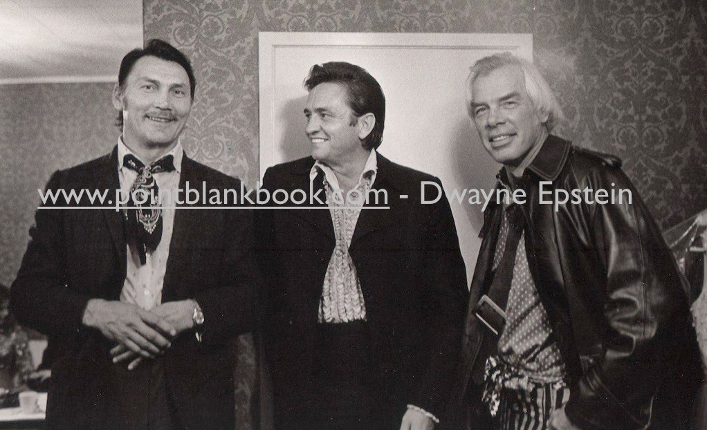 Jim Marshal's pic of Jack Palance (left) and Lee Marvin (right) backstage in dressing room with Johnny Cash (center) in 1969.