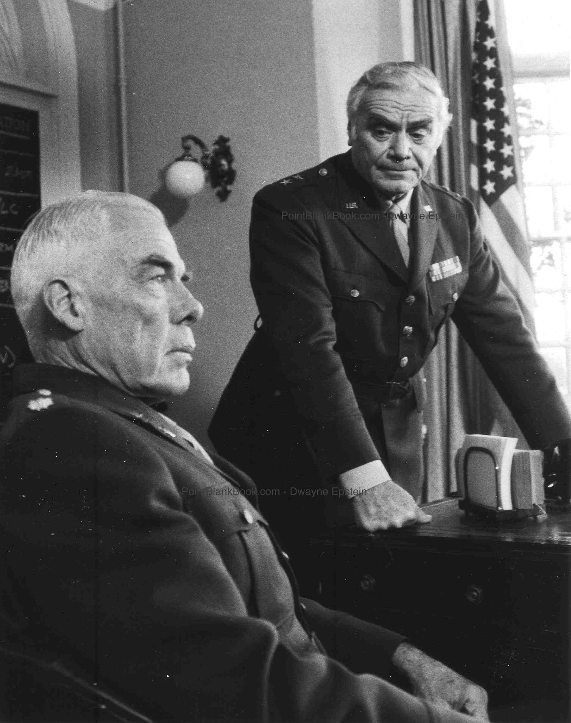 Lee Marvin (left), looking a wax museum from the Hollywood Museum gets his orders from General Ernest Borgnine