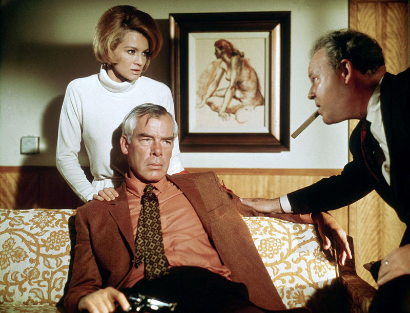 Walker's sister-in-law (Angie DIckinson) and syndicate boss (Carroll O'Connor) apprehensively wait to see what Walker (Lee Marvin) will do next.