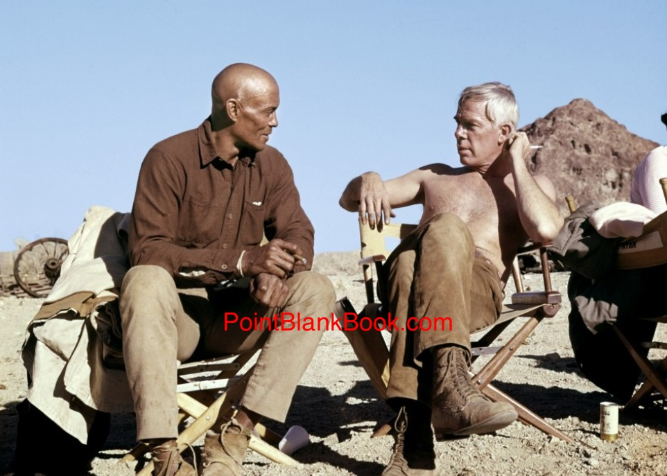 Relaxing between scenes on the set of The Professionals are good friends Woody Strode and Lee Marvin.