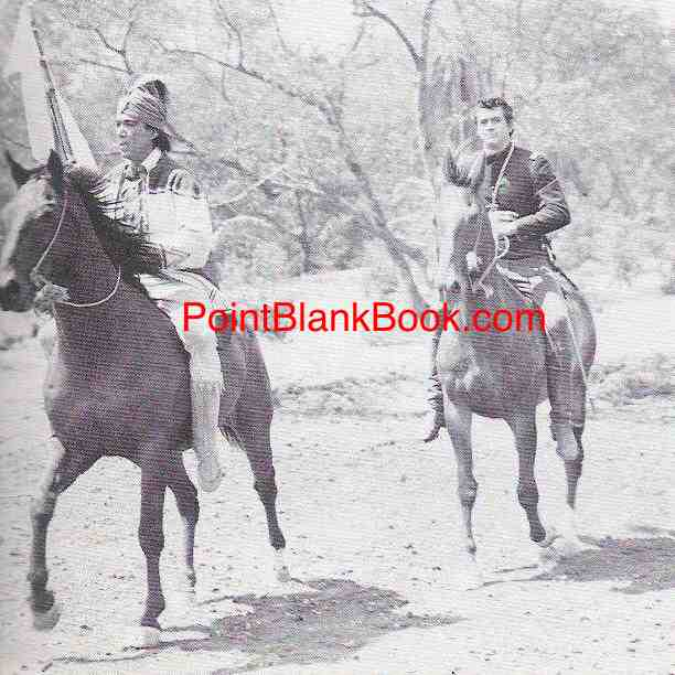 Anthony Quinn as Osceola (left) and childhood friend Rock Hudson (right) ride off together in dubious battle.