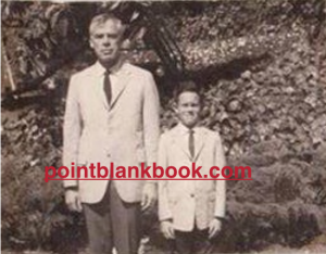 Christopher and his father wearing matching suits in the early 1960s.