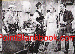 Lee Van Cleef (far left) watches as Lee 'Liberty Valance' Marvin holds his own up against film legends Jimmy Stewart and John Wayne.