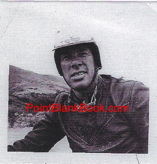 A mud splattered Lee in his motorcycle leathers smiles for wife Betty's camera. The helmet, a gift from Betty, had two connecting hearts on the front with their initials inside.