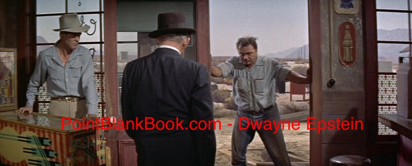 Robert Ryan (left) sics his bulldog Ernest Borgnine (right) on poor one-armed Spencer Tracy (center).