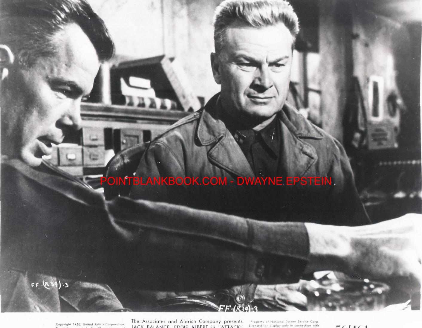 Lee Marvin (left) goes over the attack plan with Eddie Albert (right).