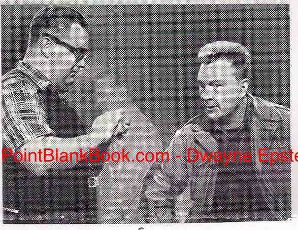 A rare photo from the film's pressbook showing director Aldrich (left) instructing actor Eddie Albert (right).
