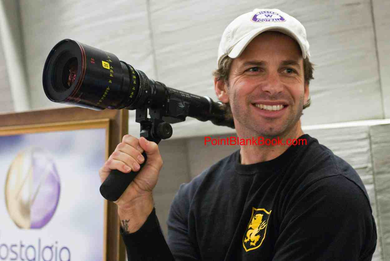 A very young looking 50-year-old Zack Snyder happily at work.