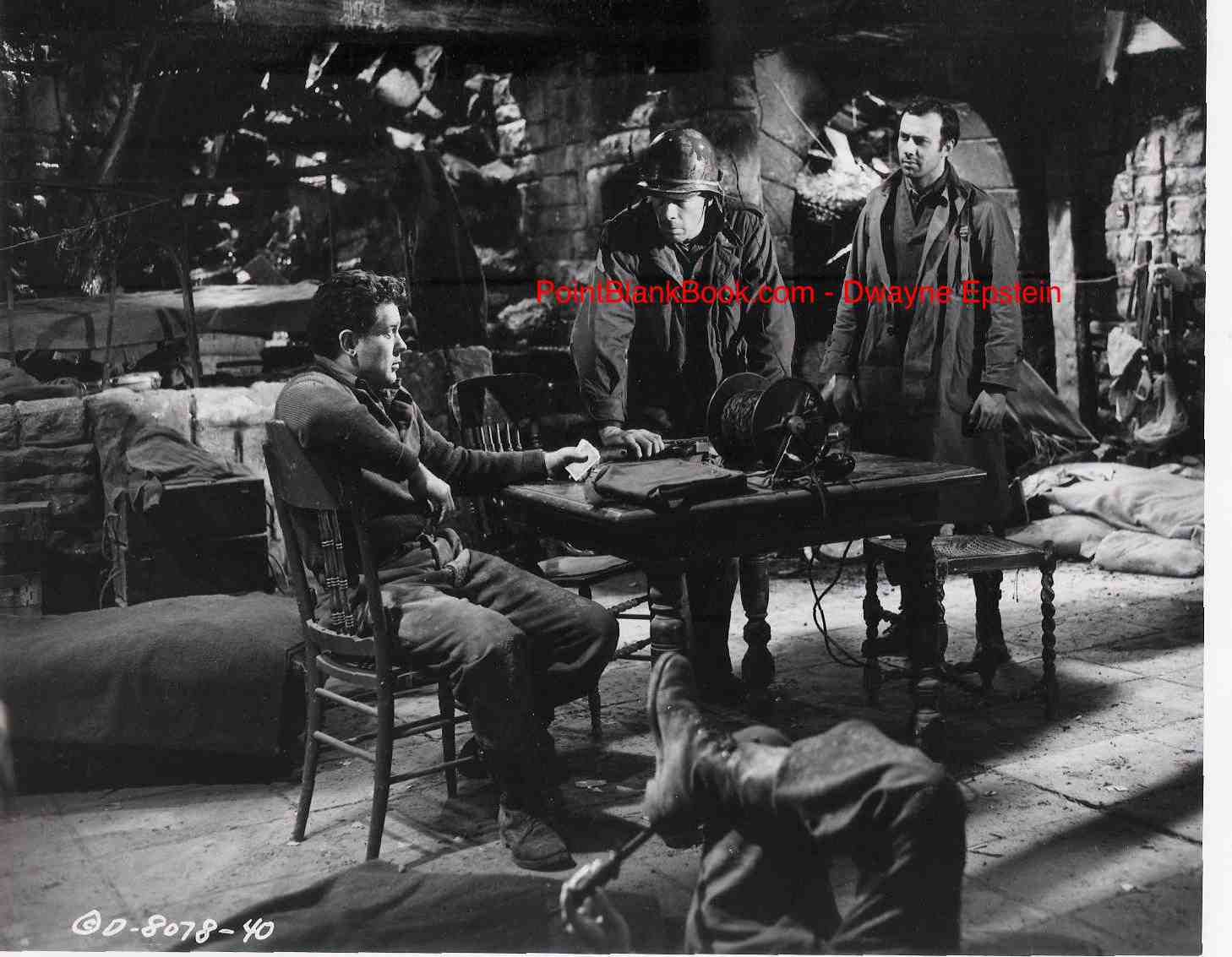 Arthur Franz (seated), Marvin and RIchard Kiley argue the fate of their comrade in 1952's EIGHT IRON MEN.