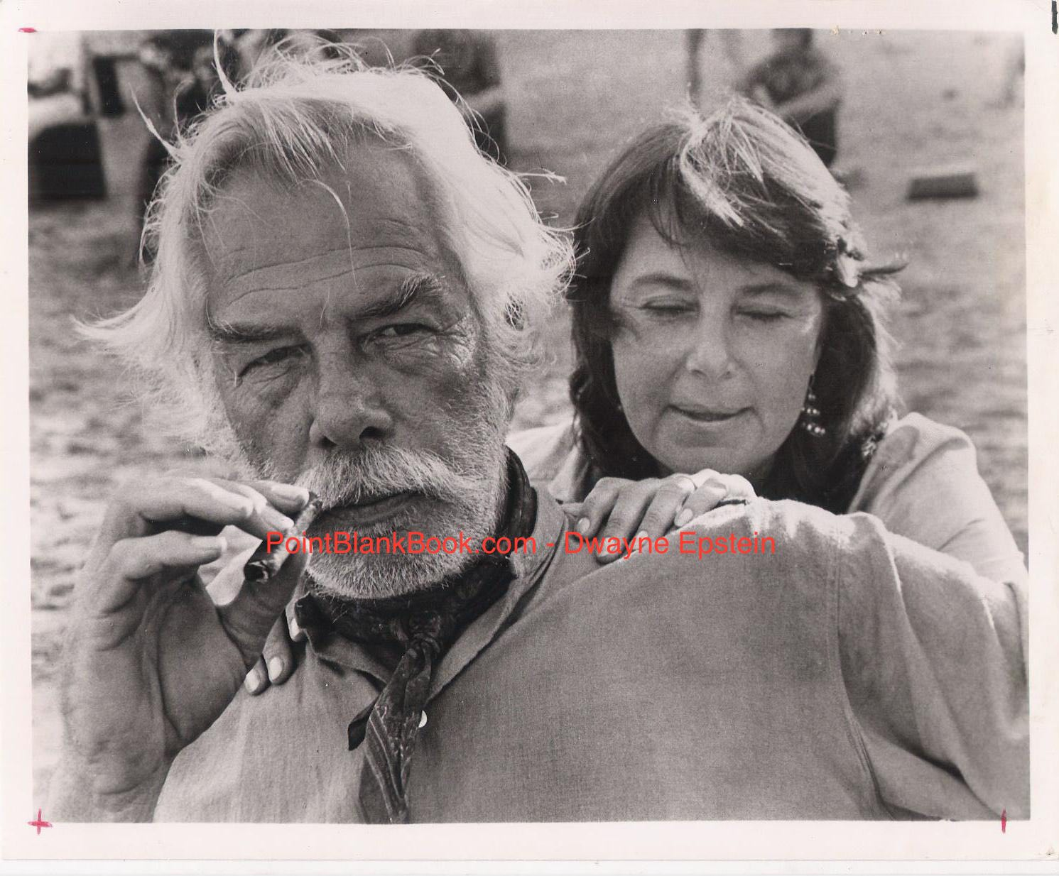 "A surly Lee Marvin, along with wife Pam, being interviewed on location in Africa for ""Shout at the Devil."""