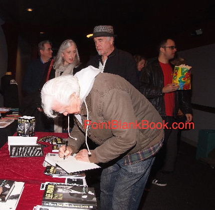 Clu Gulager signs my copy of Lee Marvin: Point Blank in the lobby of the Aero Theatre. Behind him are (L-R) publisher Tim Schaffner, Lee's daughter Cynthia Michaels, Christopher Marvin, and Cynthia's son, Lee's only grandchild, Matthew Michaels.