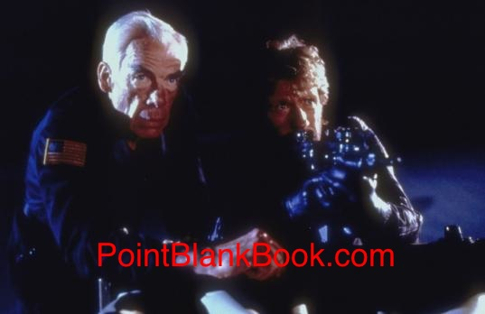 A fragile looking Lee Marvin (left), according to costar Robert Vaughn, and toplined costar Chuck Norris in DELTA FORCE.